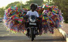 Two men transport lanterns on a motorbike in Colombo, Sri Lanka.