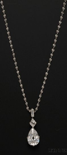 Cartier New York - An important Art Deco platinum and diamond pendant necklace. Set with a pear-shape diamond weighing 7.93 cts., and a kite-shape diamond weighing approx. 0.70 cts., and a baguette, suspended from a diamond chain set with 133 diamonds, length adjustable, pendant signed and numbered. #Cartier #ArtDeco