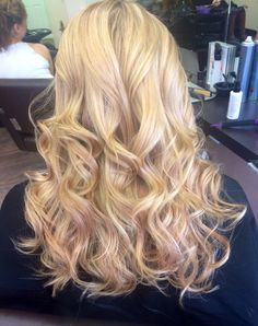 Blonde highlights with a hint of pastel pink