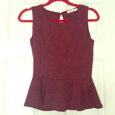 Peplum top Maroon peplum top with detailing. Worn once. Excellent condition! Comes from pet and smoke free home! Tops