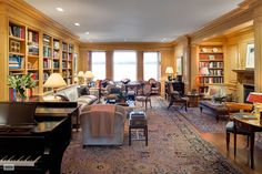 For Sale at 435 East 52nd Street, Midtown East, New York City - $8,500,000.  A set of double-doors leads to a 32-foot living room with direct River views. It has museum-quality recessed lighting, exquisite hand-carved (circa-1820s) pickled pine paneling, bookcases, and architectural details created by the same carpentry shops that Robert Adam employed at Syon House in London.