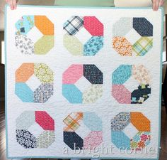 8 Charm Pack FREE Quilt Patterns Shown: Charming Lucy Quilt