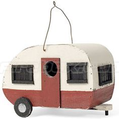 Vintage caravan birdhouse. It's made of wood with a sheet metal roof and a retro look that birds surely can't ignore.
