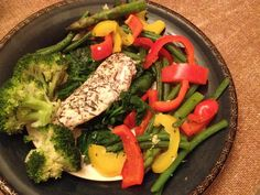 Chicken in lemon and thyme on wilted spinach, with steamed vegetables.