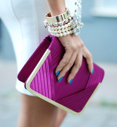 Blue nails and fuschia clutch