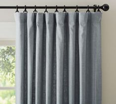 Mistakes Guys Make When Decorating To Impress Women | Laurel Home - ready-made linen curtains at Pottery Barn. Just please pin so the loops don't show as in their photo. Get them longer than you need and then re-hem. Please also check on the blog for more info on how to make cheap curtains look terrific!