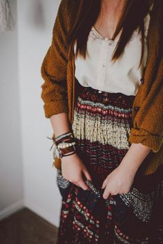 Cozy fall indie fashion- A neutral patterned maxi skirt colors paired with a cardigan