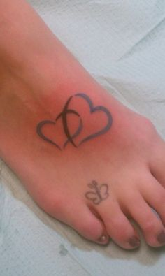 Blue hearts joined by a cross.  My husband & I both have this tattoo...A reminder of our love for each other & it is God that brought us together, not to be separated.  The butterfly doodle down by my toe is one of my older tattoos :)