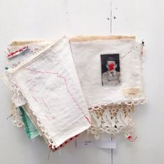 Emma Parker 'Dissociation' explores the themes of identify, memory and childhood. Photo images have been transferred onto appropriated household cloth, altered with hand embroidery and transformed into a hand sewn fabric book.