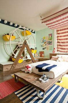 What a fun bedroom!  I like the rugs tied together....and the storage ferris wheel is delightful!!