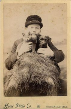 ca. 1890s, [cabinet card, unusual portrait of a bespectacled gentleman holding both a cat and a dog], Home Photo Co.  via Carl Mautz Vintage Photography, Cabinet Card Collection