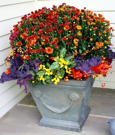 Flores Del Sol: Autumn design of rustic mums, lemon colored ornamental peppers, plum kale, bittersweet berries and orange glycerin leaves Fall Planters, Flower Planters, Garden Planters, Container Flowers, Container Plants, Container Gardening, Fall Flower Pots, Fall Flowers, Fall Containers