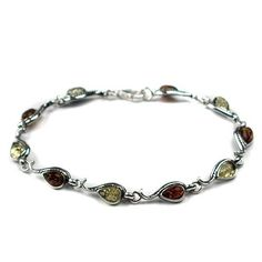 Sterling Silver Multi-color Amber Marquise-shaped Bracelet Amazon Curated Collection. $57.00. May be washed with warm, soapy water.. Gemstones may have been treated to improve their appearance or durability and may require special care.. The natural properties and composition of mined gemstones define the unique beauty of each piece. The image may show slight differences to the actual stone in color and texture