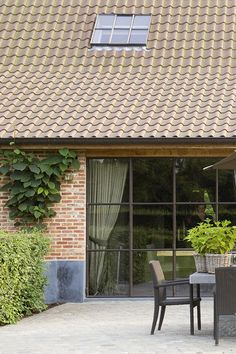 Architecture | Architects Mieke Van Herck..I like the climbing vine for my patio.