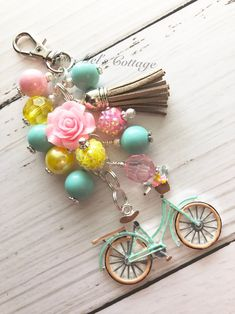 Charming Pastel Vintage Bicycle/Bike with pretty accent bead dangle and tassel Zipper Bag Charm/Keychain/purse charm/Bike/Bicycle by MissMelsCottage on Etsy Handmade Keychains, Handmade Jewelry, Beaded Jewelry, Beaded Necklace, Tassel Keychain, Chunky Beads, Zipper Bags, Jewelery, Jewelry Making
