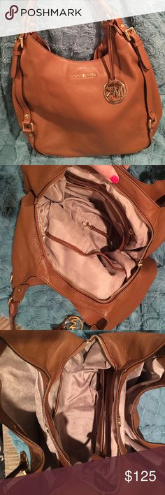 Michael Kors handbag Beautiful Michael Kors purse. Just a little too large for me. Barely carried, in perfect condition. From a smoke free home. Cognac leather. Three compartments. Dog leash for your keys. Tons of organization with this bag! KORS Michael Kors Bags Shoulder Bags