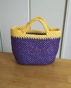 犬のお散歩用バッグを編みました。久しぶりのスズランテープ編み。紫色は何年か前に編んで残った物。結局足りなくて黄色を買い足して、仕上げました。 . #かぎ針編み #編み物 #バッグ #スズランテープ #スズランテープバッグ #犬の散歩 #お散歩バッグ #ハンドメイド  #手作り  #クロッシェ  #crochet  #handmade #bag