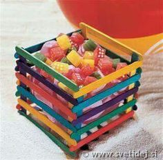 DIY box made from colored ice drop sticks joined together with melted glue sticks Lolly Stick Craft, Ice Cream Stick Craft, Popsicle Stick Art, Popsicle Stick Crafts, Craft Stick Projects, Craft Stick Crafts, Craft Sticks, Craft Ideas, Kids Crafts
