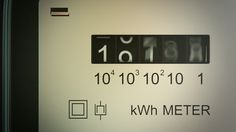Typical residential analog electric meter with transparent plastic case showing household consumption in kilowatt hours. Electric power usage. - HD stock video clip