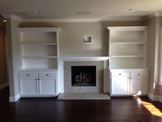 built-in shelves around fireplace | Built in cabinets around fireplace ...