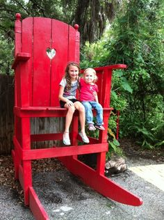 Love this bright red giant chair. A giant wooden stool be great for story telling!