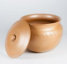 Micaceous clay pot, by Therese Tohtsoni-Prudencio, can be used in the oven or stovetop with a heat diffuser, like a cast iron griddle or comal.
