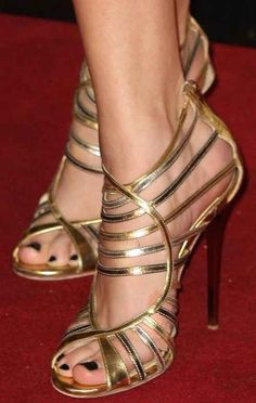 Intricate strappy gold heels.