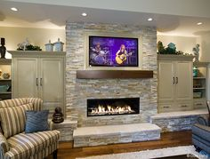 Living Room fireplace with built in storage on either side.