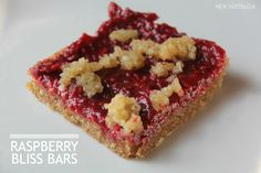 New Nostalgia: Raw Raspberry Bliss Bars.  These are full of Omega's.  Healthy enough to eat for breakfast but tastes like a decadent dessert.  No sugar.  Raw.  I've made them TWICE this week already!  #healthy #raspberry #chia