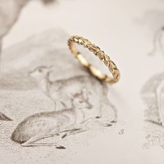 Laurel leaf wedding band by Rust
