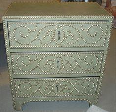 nailhead and crackle-finish leather dresser. Dalton Designs. ~~