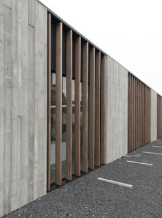 The use of timber formwork translates through to the vertical solar shading...