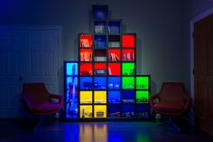 """The room's """"Tetris Wall"""" stores all of the controllers, gaming discs and cartridges."""