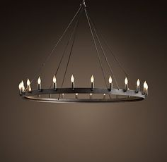 """RH's Camino Vintage Candelabra Round Chandelier 50"""":Rustic in style, simple in form and grandly sized, our hand-forged chandelier designed by industrial blacksmith Jon Sarriugarte makes an elegant statement. Drawing inspiration from early 20th century industrial fixtures, it's built of stout angle iron."""