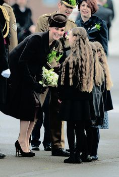 """Are those for me?"" A clearly delighted Duchess of Cambridge was presented with a posy by a trio of little girls"