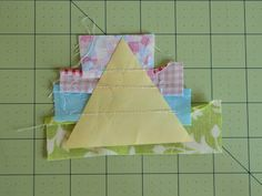 "I'm working on a small project using small scraps. These triangles finish at about 3"", give or take. I took this project to my little neighb..."