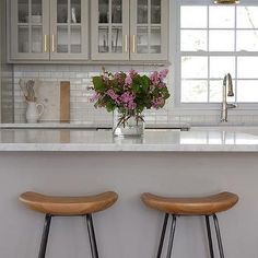 Gray Glass Front Kitchen Cabinets with Brushed Brass Pulls