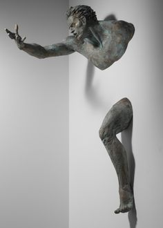 Athletic Bronze Sculpture Emerges  from Wall by Matteo Pugliese