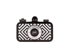 I really want this camera- Effortlessly classy and stylish in its monochromatic diamond pattern, La Sardina Domino Pattern Edition boasts multiple-exposure capabilities and a smooth-scrolling rewind dial. It's exceptionally talented in producing gorgeous wide-angle photos!