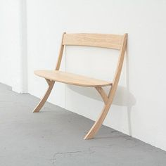Two-legged bench designed to rest against a wall.