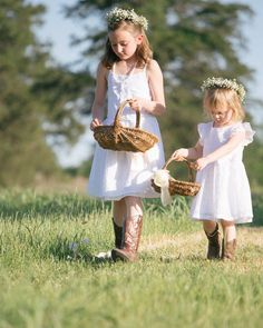 With their delicate arrangements of baby's breath, white dresses, and cowboy boots, these adorable flower girls were rustic-chic from head to toe.