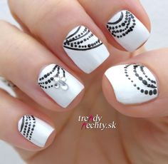 white nail polish and black pattern