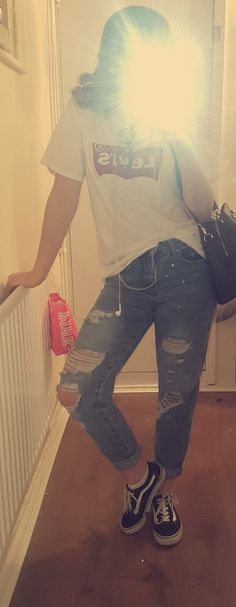 Classic: boyfriend jeans with an oversized Levi top and a pair of vans.