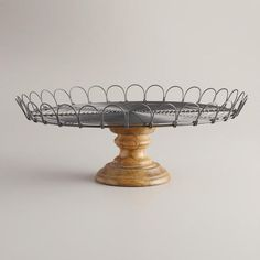 The unique design of our Edin Pedestal Stand blends a metal top with a wooden base. Crafted in India, this piece is a perfect way to showcase anything from fruit, flowers or baked goods while hosting family and friends. Display Pedestal, Pedestal Stand, Pedestal Cake Stand, Wood Pedestal, Metal Cake Stand, Food Photography Props, Tiered Stand, Galvanized Metal, World Market