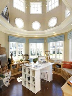 Sunny Studio: This circular home art studio has lots of windows that let in natural light, and built-ins lining the wall provide storage and seating. From HGTVRemodels.com