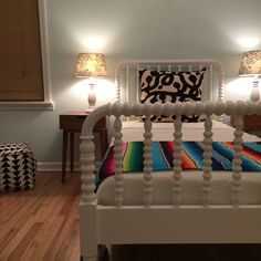Kids room.  Land of Nod Jenny Lind bed.  Pouf and side tables from target.  Serape blanket.  Pillow from Ikea.  Lamp shades from Urban Outfitters.  Wall paint is Crystal Blue by Benjamin Moore.