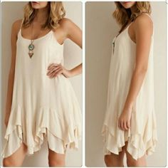 Nude Slip Dress Tunic Beautiful. Great for layering as a slip or wear alone. Fully lined. Adjustable straps. Size small. Nude Cream color. Brand new Dresses