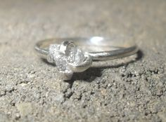 Rough Diamond Engagement Ring- Sterling Silver Prong Set Solitaire. $105.00, via Etsy. - I'm not one for posting marriage-related crap, but this is just a beautiful ring.  Definitely me.