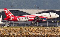 AirAsia (MY) Airbus A320-216 9M-AFP aircraft, painted in ''1 Malaysias'' special colours Jan. 2007 - Dec. 2012, & the sticker ''1'' on the airframe, landing at China Hong Kong Chek Lap Kok International Airport. 06/07/2014. (1 Malaysia= an ongoing programme designed by Malaysia Prime Minister Najib Tun Razak on 2010 calling for the cabinet, goverment agencies etc).