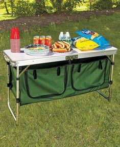 The Portable Camping Table lets you prepare and serve food on top and store supplies underneath. Below the foldable table are two large zippered storage